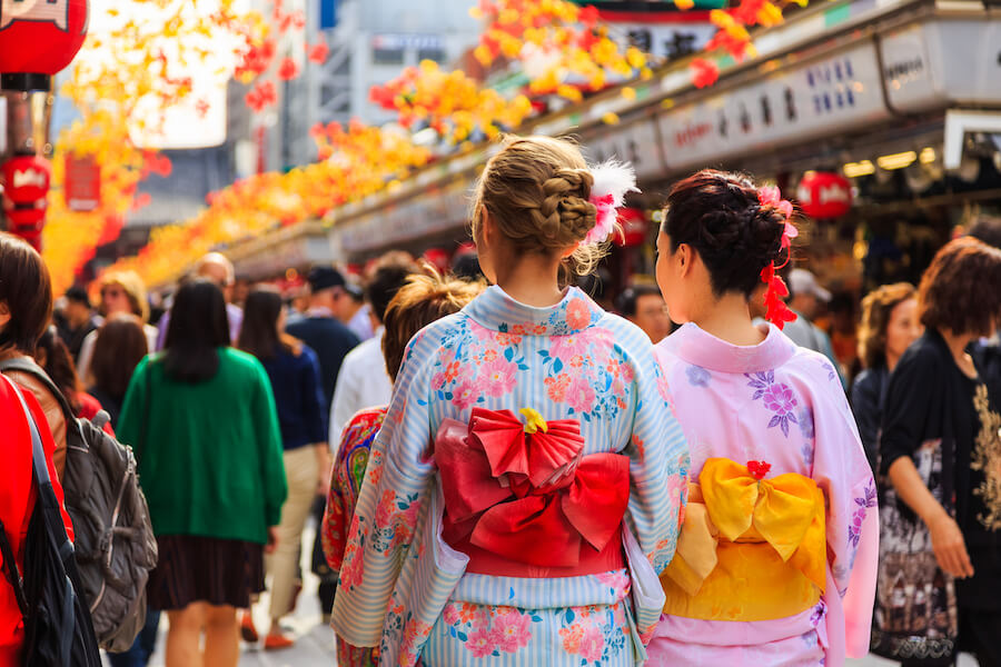 tourist wearing kimono, the national tradition costume of Japan walking at Sensoji temple the famous temple in Tokyo, Japan Guide