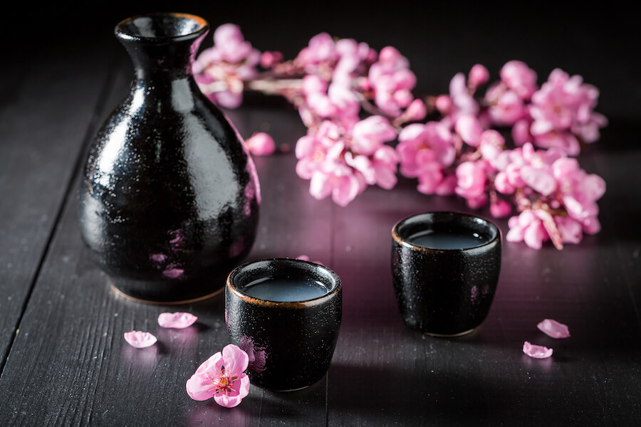 Unfiltered strong sake in black ceramics on dark table - Sake Guide