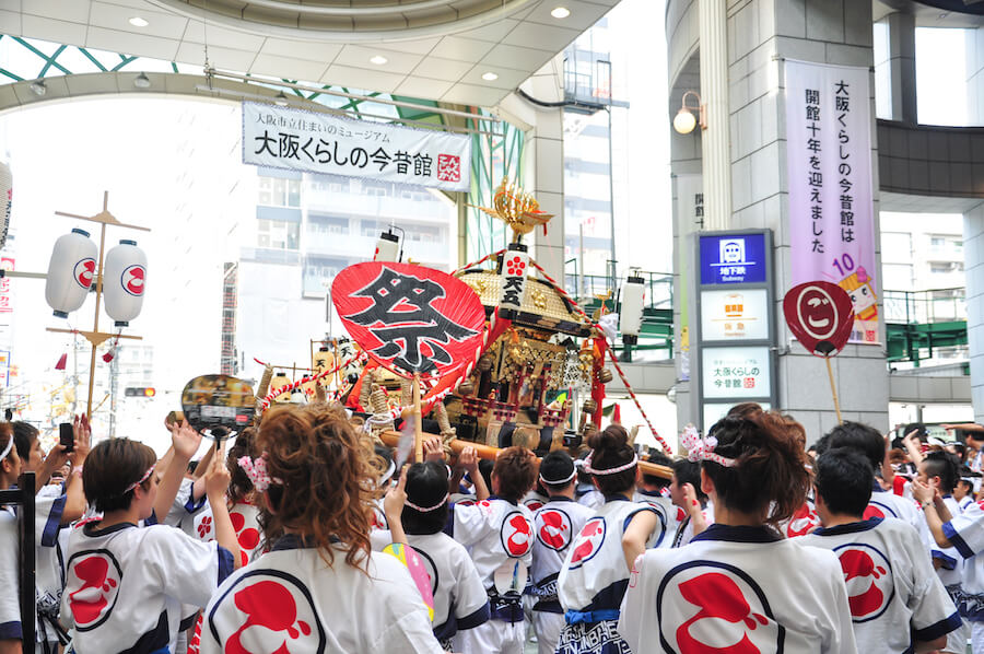 Participants of Tenjin Matsuri worships the golden shrine - top japanese festival