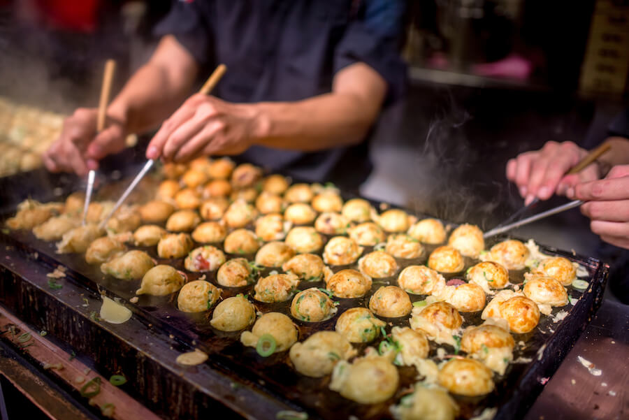 Takoyaki cooking by chef - 10 Food you need to try in Japan