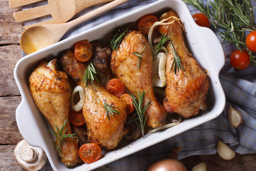Baked chicken legs with mushrooms and vegetables. horizontal top - keto recipes