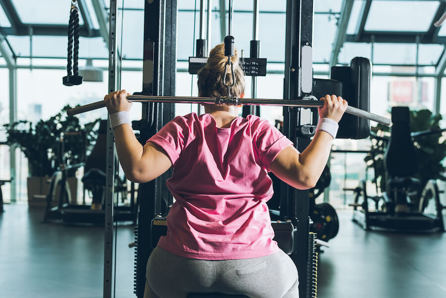Overweight woman working out - how to get into ketosis