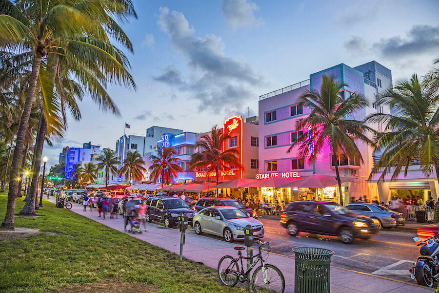 People enjoy palms and art deco hotels at Ocean Drive - Places to visit in the USA