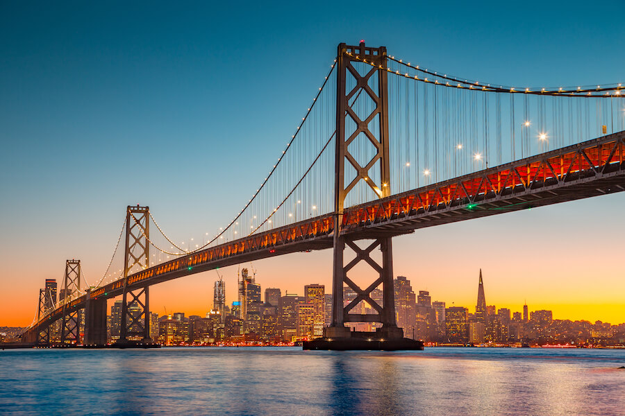 San Francisco skyline with Oakland Bay Bridge at sunset, California, USA - Places to visit in the USA
