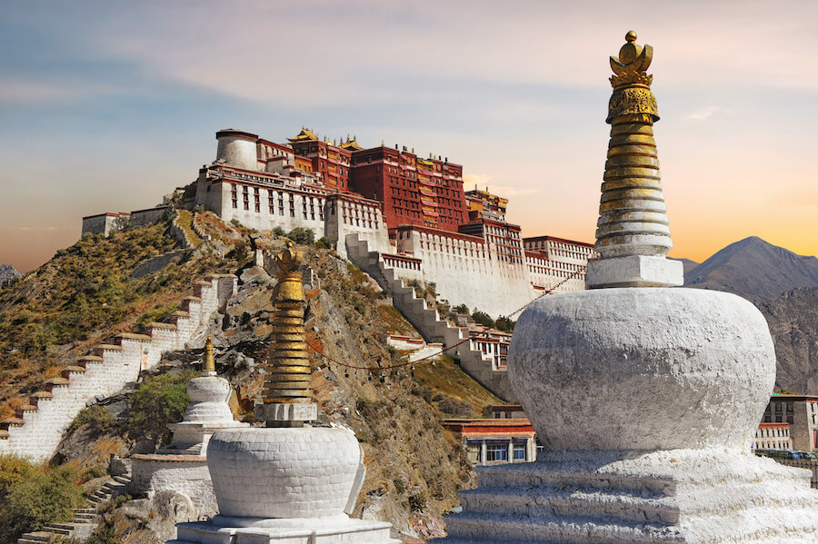 Potala Palace in Tibet during sunset - Best places to visit each month of the year