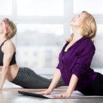 Senior women doing the cobra pose - How To Regain Flexibility After 50