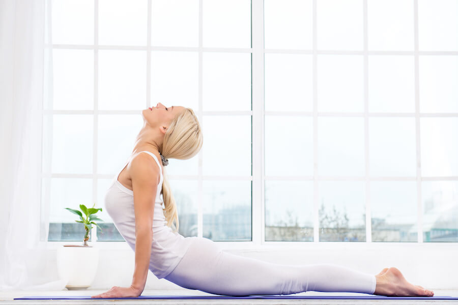 Woman doing cobra pose - yoga poses you should practice