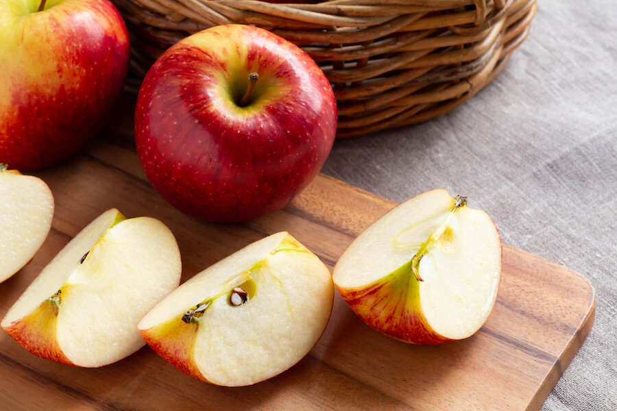 apples on table - foods that burn belly fat