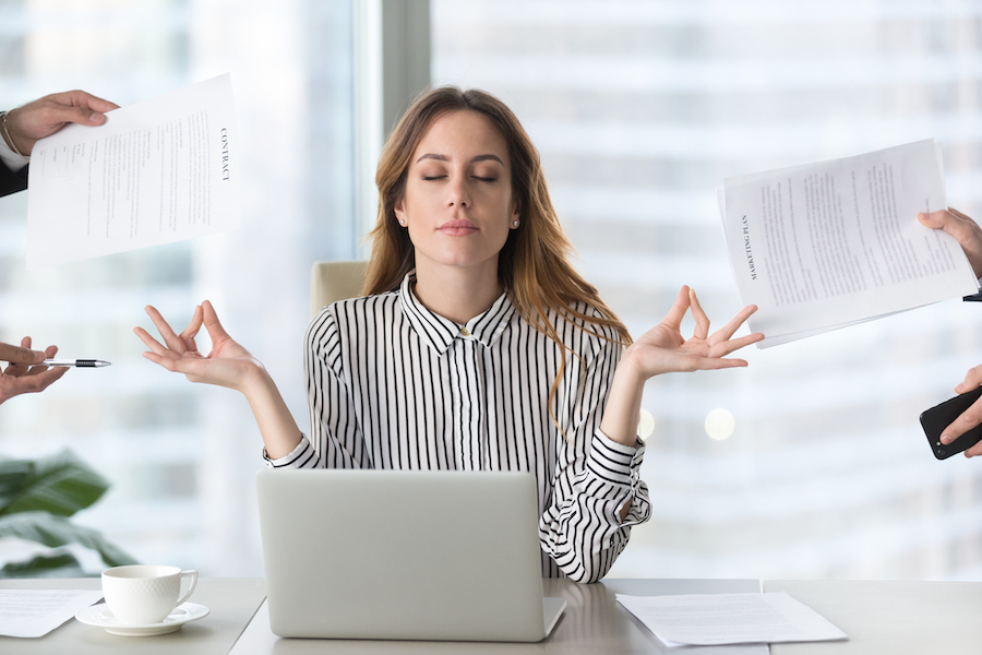 calm female in office - health benefits of yoga that makes you practice every day