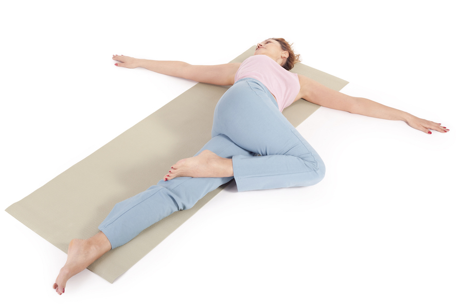 supine spinal twist - yoga poses to fall asleep faster