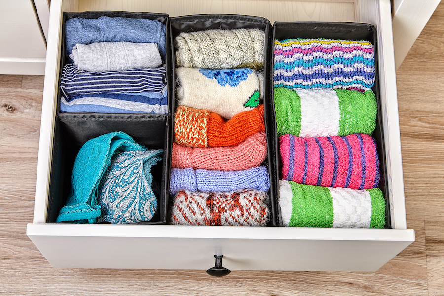 Boxes for separate storage of linen in a drawer.