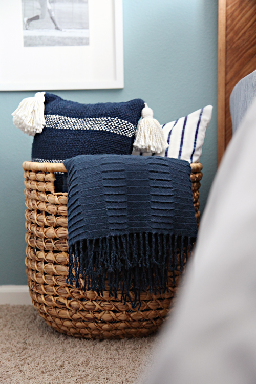 throw pillow basket - bedroom organization ideas