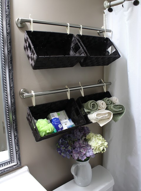 baskets hanging on towel rods - bathroom organization ideas