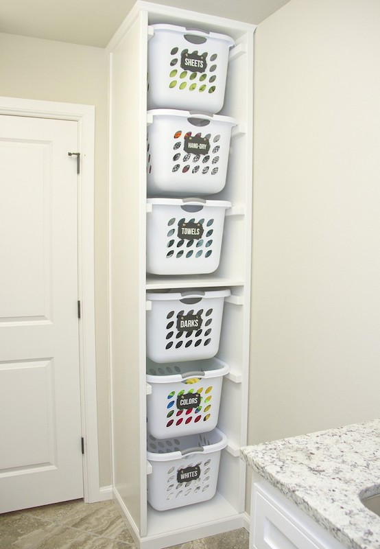 Laundry baskets labelled with colors - laundry room hacks