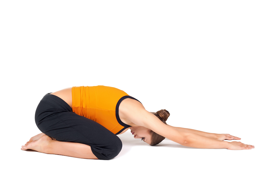 Woman Doing Extended Child Pose Yoga Asana